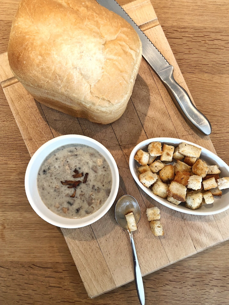 Mushroom soup with bread and croutons