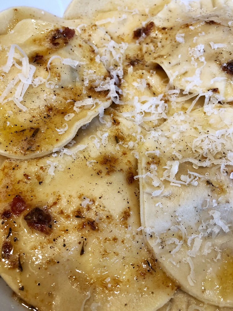 Homemade Ravioli with grated Parmesan and beurre noisette