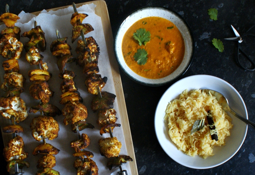 Skewers, makhani sauce and pilau rice